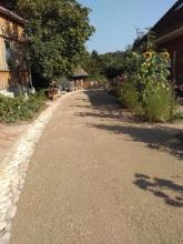 Zufahrt aus wassergebundener Wegedecke (Kies) gartenbau breuer